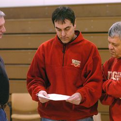 (left to right) Judge Assistant coach Marty Giovacchini, Judge boys prep basketball coach Jim Yerkovich, and Judge assistant coach Dan DelPorto, go over plays during a practice of the Judge Memorial boys prep basketball team at Westminister College in Salt Lake February 20, 2006. Yerkovich is in his 40th year of coaching at Judge Memorial High School in Salt Lake City. Mark DiOrio/Deseret Morning News