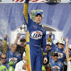 Brad Keselowski celebrates in victory lane with his crew after winning the NASCAR Sprint Cup Series auto race at Chicagoland Speedway in Joliet, Ill., Sunday, Sept. 16, 2012.