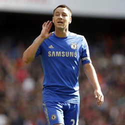 Chelsea's John Terry gestures as he tries to listen to instructions from his goalkeeper Petr Cech during the English Premier League soccer match between Arsenal and Chelsea at the Emirates Stadium in London, Saturday, Sept. 29, 2012.