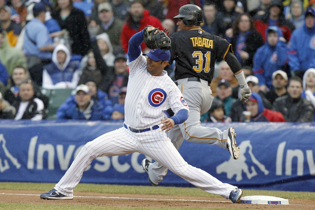 Carlos Pena of the Chicago Cubs digs a throw out of the dirt before Jose Tabata of the Pittsburgh Pirates can get to the base during opening day at Wrigley Field on April 1, 2011 in Chicago, Illinois.  (Photo by Gregory Shamus/Getty Images)