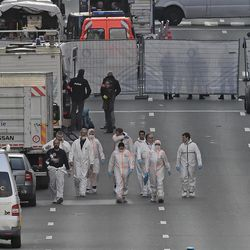 Forensic staff leave the metro station Maelbeek in Brussels, Tuesday, March 22, 2016. Explosions, at least one likely caused by a suicide bomber, rocked the Brussels airport and its subway system Tuesday, prompting a lockdown of the Belgian capital and heightened security across Europe.