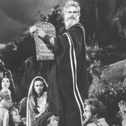 """This undated file photo, originally supplied by American Movie Classics, shows Yvonne De Carlo, third from left, kneeling beside Charlton Heston as he played Moses and she played his wife in """"The Ten Commandments."""""""