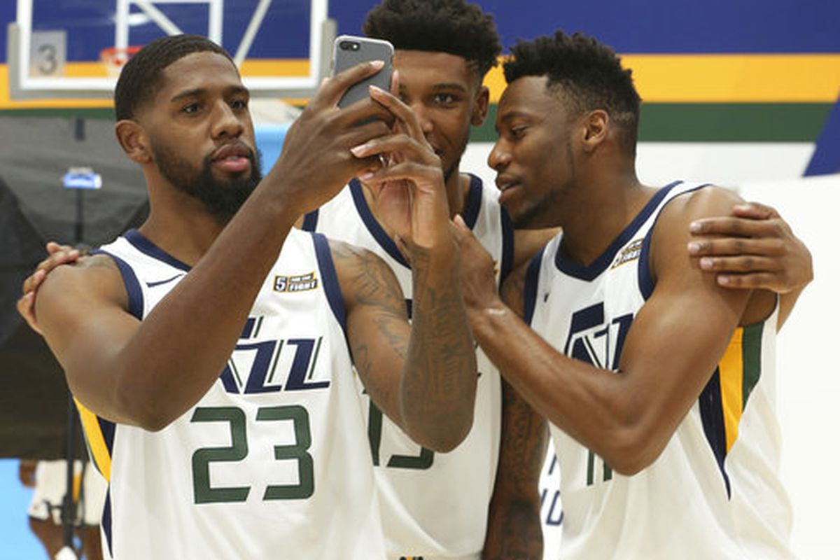 Utah Jazz's Royce O'Neale, Tony Bradley and Eric Griffin, from left, poses for photos at the NBA basketball team's media day, Monday, Sept. 25, 2017, in Salt Lake City.