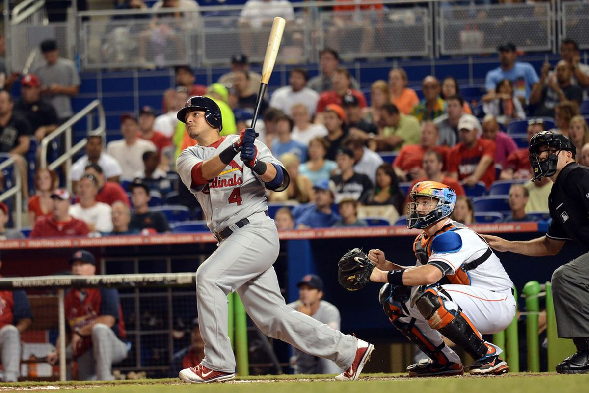 June 26, 2012; Miami, FL, USA; St. Louis Cardinals catcher Yadier Molina (4) connects for a three run home during the first inning against the Miami Marlins at Marlins Park. Mandatory Credit: Steve Mitchell-US PRESSWIRE