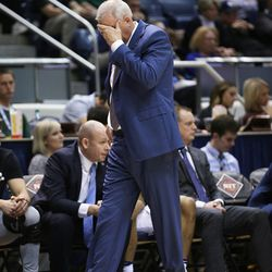 Brigham Young Cougars head coach Dave Rose rubs his head after a late game turnover as BYU falls to the University of Texas at Arlington play in NIT basketball action at the Marriott Center in Provo, Utah on Wednesday, March 15, 2017.