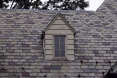 Small dormer with a pointy roof that slopes down on either side.