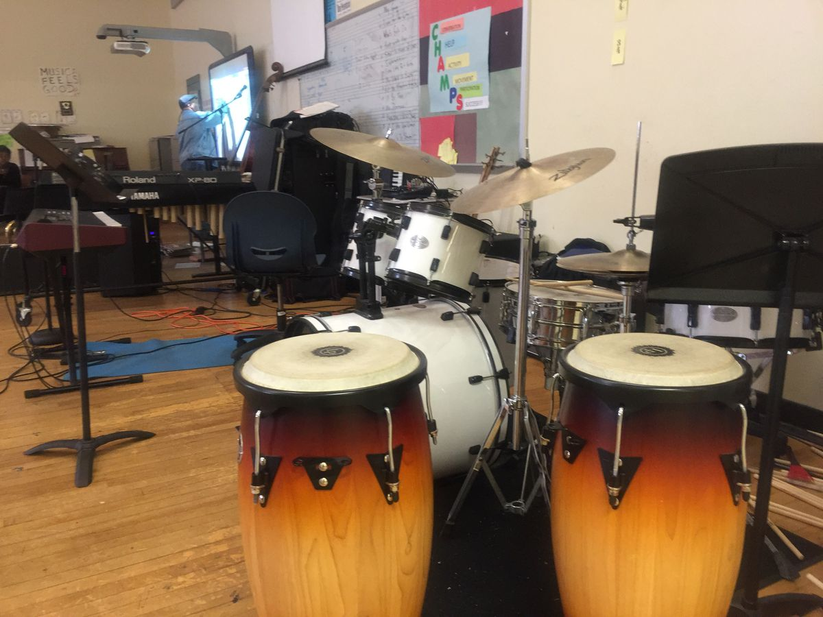 Music teacher Quincy Stewart said he used his own money to buy many of the musical instruments his students use at Detroit's Central High School.