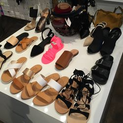 The sandal selection, including Joie Sable metallic sliders in white and rose gold, $94.50 (was $120)