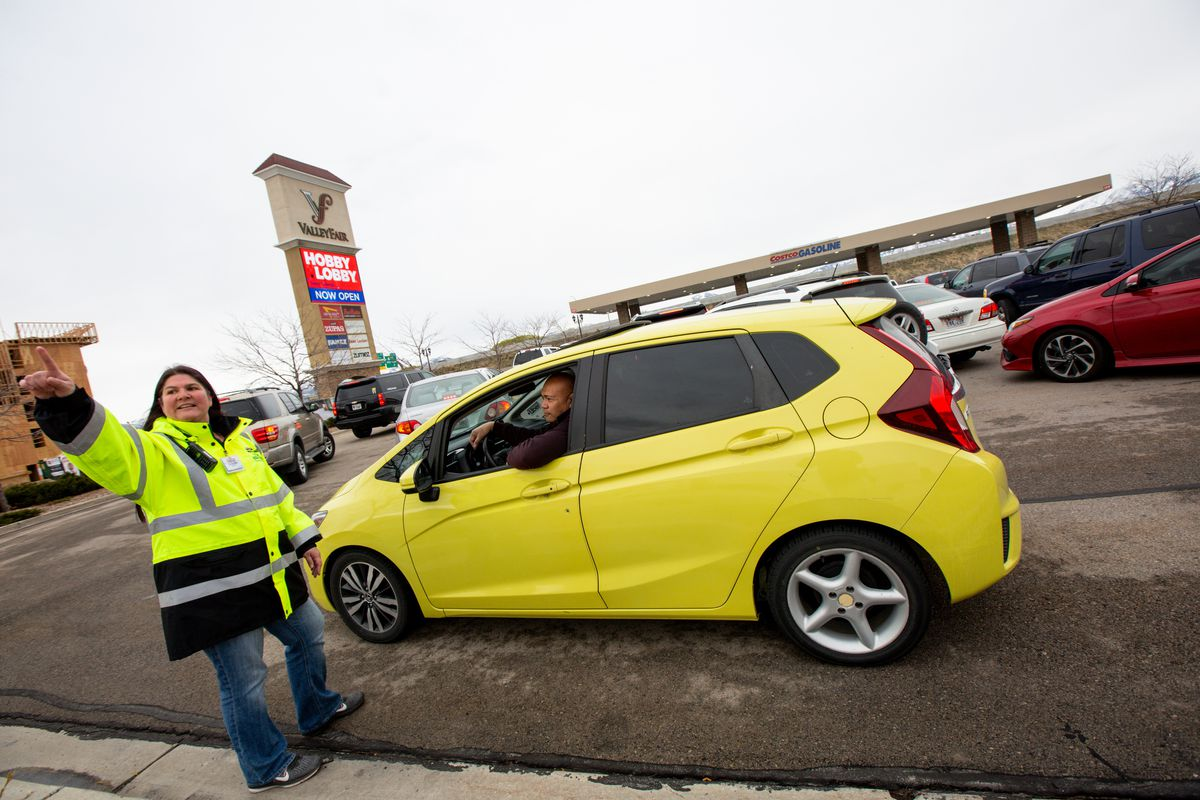 Shauna Rodriguez shows Will, no last name given, where the line of cars to get gas began at the Costco in West Valley City on Wednesday, March 18, 2020, following a 5.7 magnitude earthquake that was centered in Magna. Both remembered experiencing the 1989 Loma Prieta earthquake in the San Francisco Bay area.