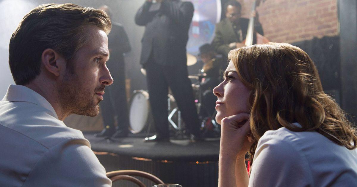 Emma Stone looking at Ryan Gosling's face in La La Land