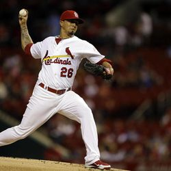 St. Louis Cardinals starting pitcher Kyle Lohse throws during the first inning of a baseball game against the Houston Astros, Tuesday, Sept. 18, 2012, in St. Louis.
