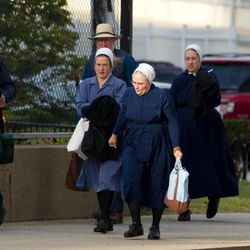 A group of Amish walk to the U.S. Federal Courthouse in Cleveland on Thursday, Sept. 20, 2012.  The jury will begin their fifth day of deliberations in the trial of 16 Amish people accused of hate crimes in hair- and beard-cutting attacks against fellow Amish in Ohio.