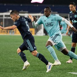 FOXBOROUGH, MA - APRIL 20: New England Revolution forward Juan Fernando Caicedo #9 chases down New York Red Bulls defender Connor Lade #5 during the second half at Gillette Stadium on April 20, 2019 in Foxborough, Massachusetts. (Photo by J. Alexander Dolan - The Bent Musket)