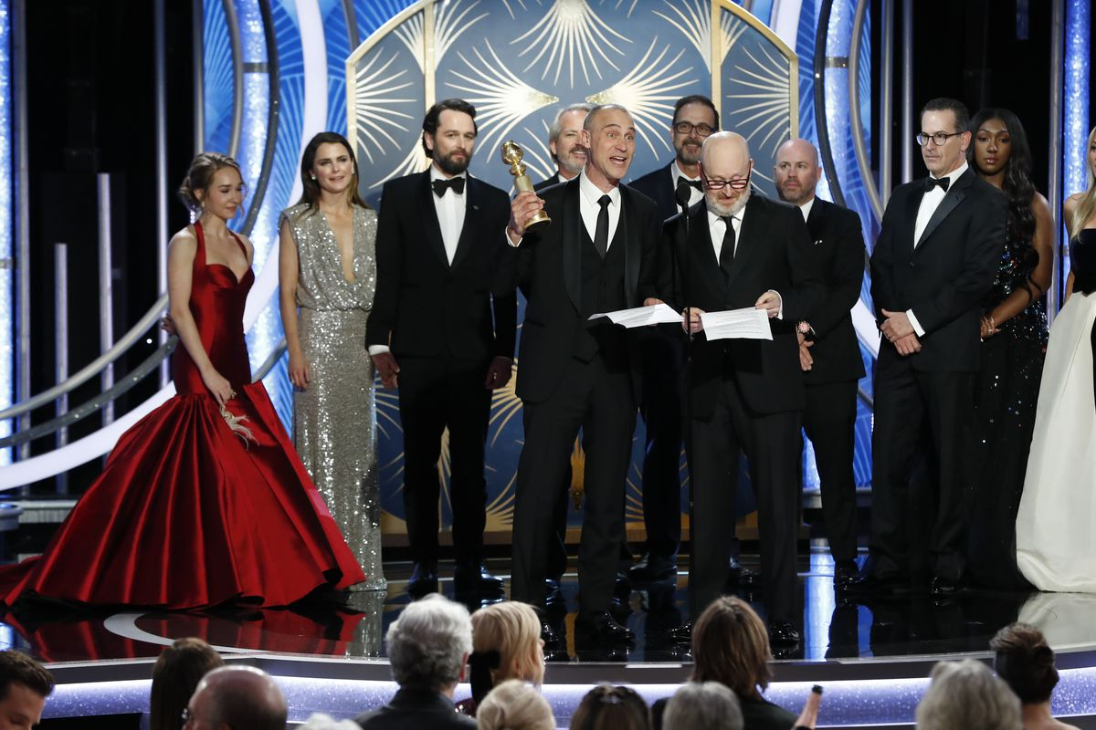 """The cast of the TV show """"The Americans"""" onstage at the Golden Globes accepting the award for Best Television Series — Drama."""