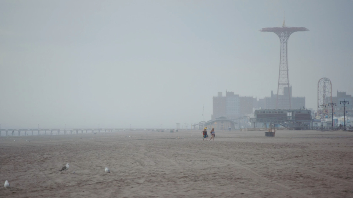 Coney Island beach, rendered as sci-fi in The Hottest August.