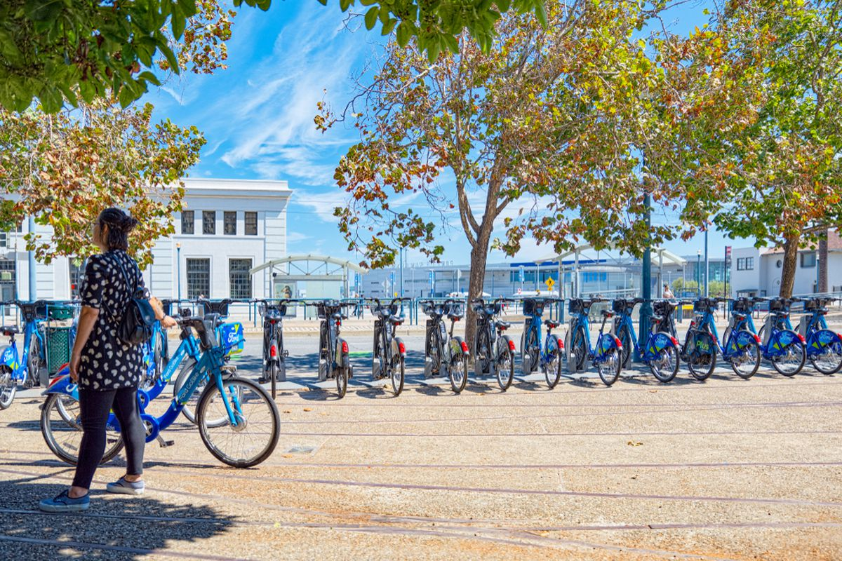 Blue Ford GoBikes lined up near the SF waterfront.
