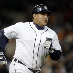 Detroit Tigers' Miguel Cabrera runs the bases after hitting a grand slam against the Oakland Athletics in the eighth inning of a baseball game in Detroit on Tuesday, Sept. 18, 2012.