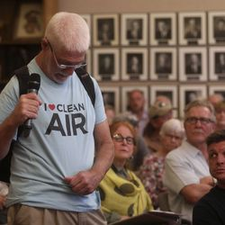 """A man shows his """"I Heart Clean Air"""" shirt while speaking in opposition to a proposed property tax increment reimbursement of up to $28 million for development of an inland port during a Salt Lake City Council Redevelopment Agency meeting at the City-County Building in Salt Lake City on Tuesday, Aug. 20, 2019."""