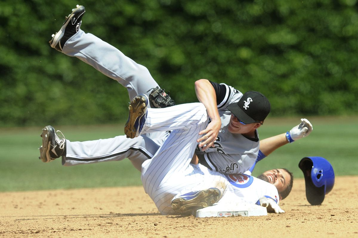 Accident or no, DeJesus should have been ruled safe: Gordon Beckham of the Chicago White Sox tags out David DeJesus of the Chicago Cubs at Wrigley Field in Chicago, Illinois.  (Photo by David Banks/Getty Images)