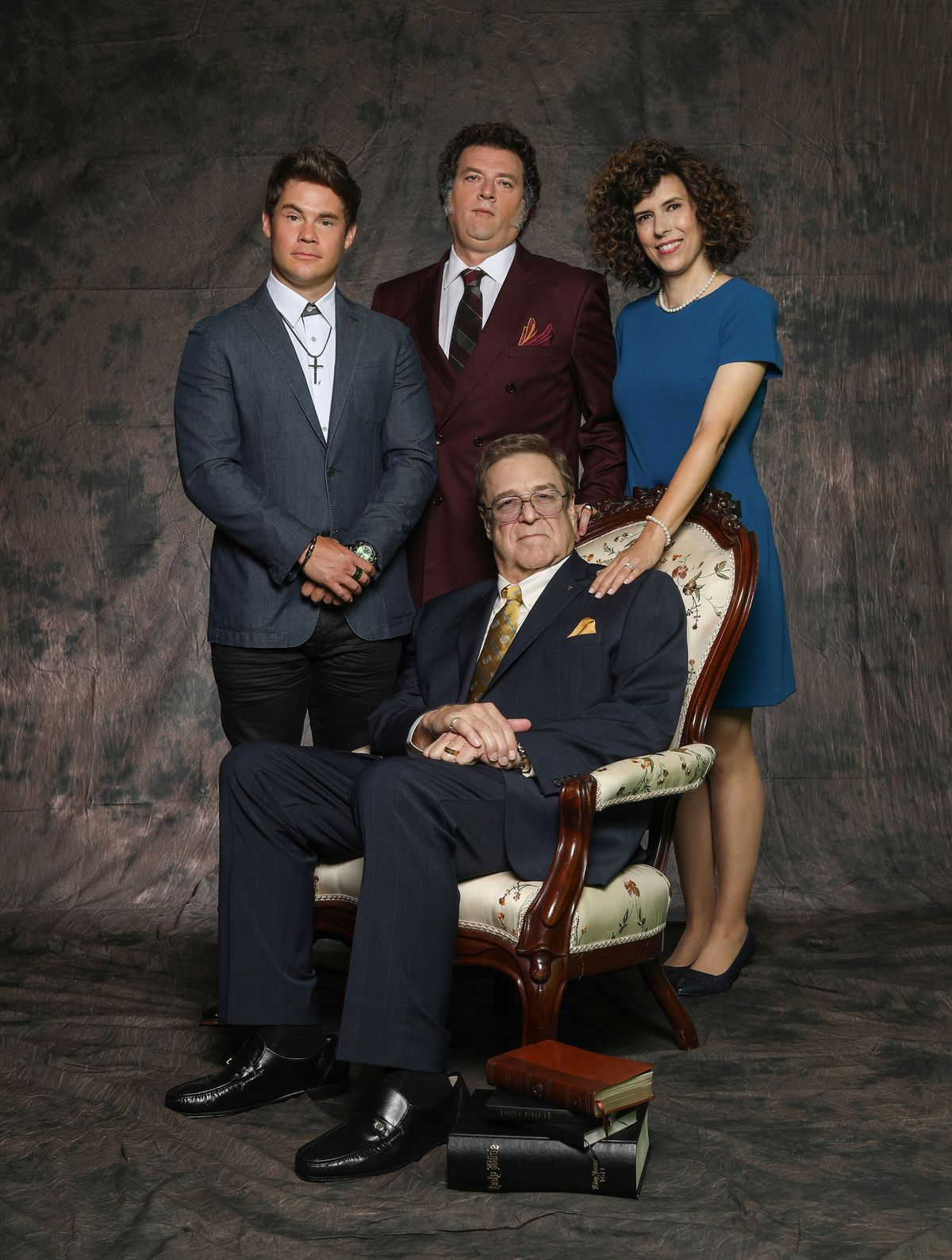Kelvin (Adam Devine), Jesse (Danny McBride), and Judy (Edi Patterson) stand behind the seated Eli (John Goodman) in a family portrait in The Righteous Gemstones