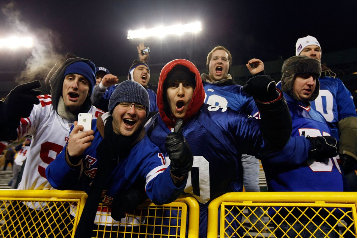 Fans of the New York Giants celebrate after their team defeated the Green Bay Packers during their NFC Divisional playoff game at Lambeau Field on January 15, 2012 in Green Bay, Wisconsin.  (Photo by Scott Boehm/Getty Images)