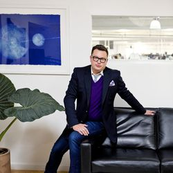 <b>Graham Wetzbarger</b>, Senior Director of Authentication, wearing a Gucci Blazer (from TRR), Ermenegildo Zegna cashmere sweater, Neiman Marcus French cuff shirt, Burberry knit tie, Hermès pocket square, Lego cufflinks from Etsy, G Star Jeans, a Gucci b