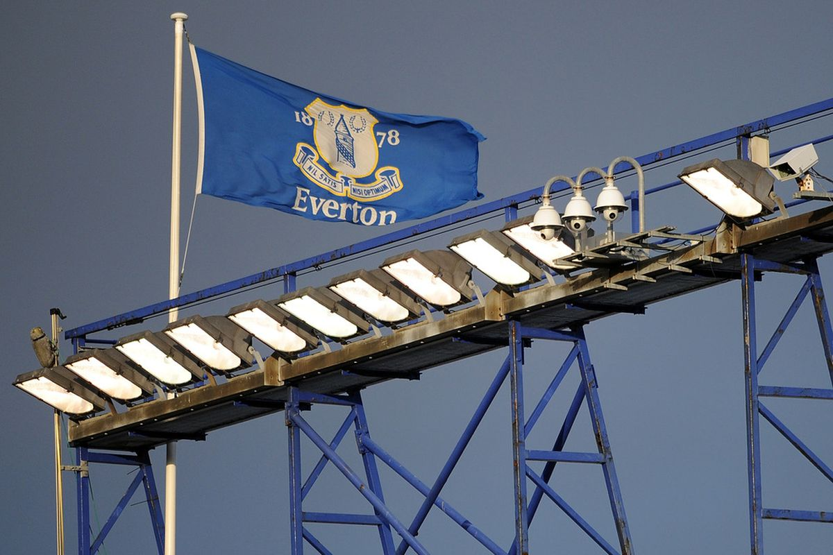 LIVERPOOL, ENGLAND - FEBRUARY 18:  An Everton flag flies above the stadium during the FA Cup Fifth Round match between Everton and Blackpool at Goodison Park on February 18, 2012 in Liverpool, England.  (Photo by Chris Brunskill/Getty Images)