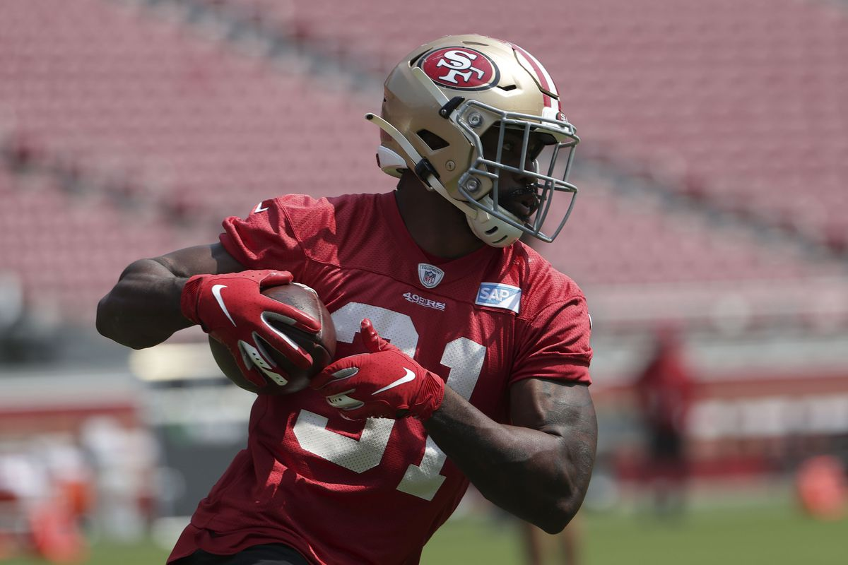 San Francisco 49ers running back Raheem Mostert runs with the football during training camp at Levi s Stadium.