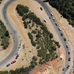 Riders in the Tour of Utah make their way up the south side of Payson Canyon on Wednesday, Aug. 3, 2016.