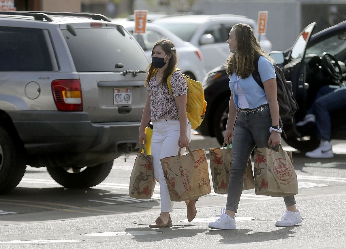 Rylie Cote and Paige Sherwood carry groceries after shopping in Orem on Monday, Sept. 14, 2020. The majority of recent COVID-19 cases are among people between the ages 14-24, many of them living in Utah County.