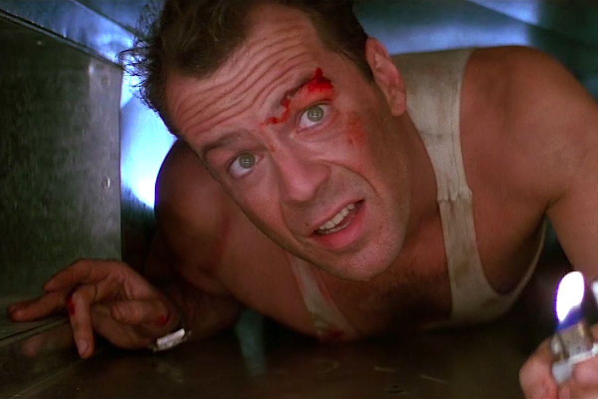 John McClane crawls through an air duct in a still from Die Hard