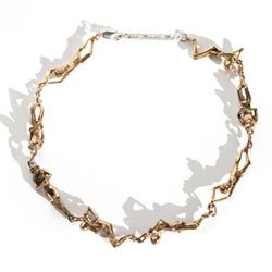 Eight little bronze nudes are joined from head to toe to form this choker.
