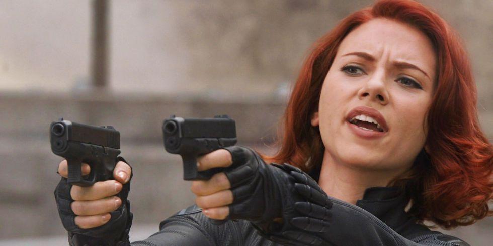 Black Widow holding two pistols