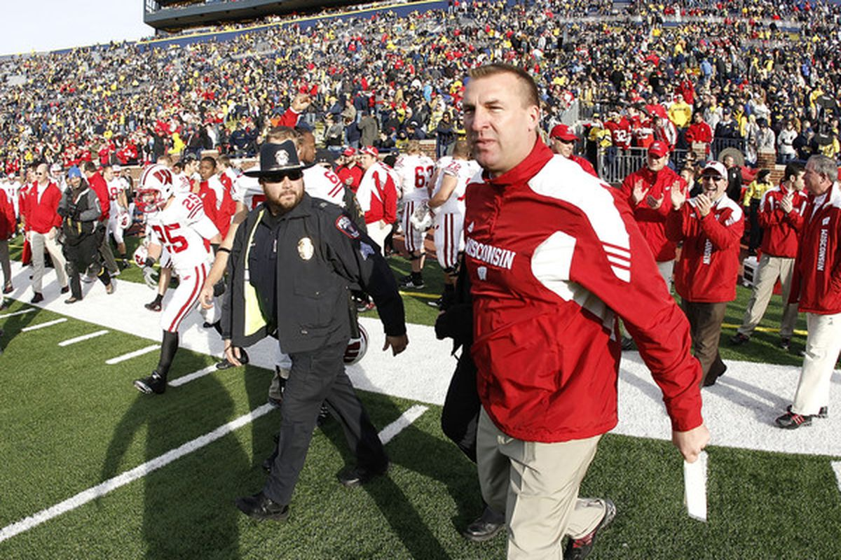 ANN ARBOR MI - NOVEMBER 20: Head coach Bret Bielema of the Wisconsin Badgers heads onto the field after defeating the Michigan Wolverines 48-28 at Michigan Stadium on November 20 2010 in Ann Arbor Michigan.  (Photo by Gregory Shamus/Getty Images)