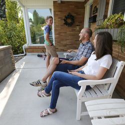 Jon and Natalie Larsen talk with son Eric as they sit in front of their home in Millcreek on Wednesday, Sept. 16, 2020.