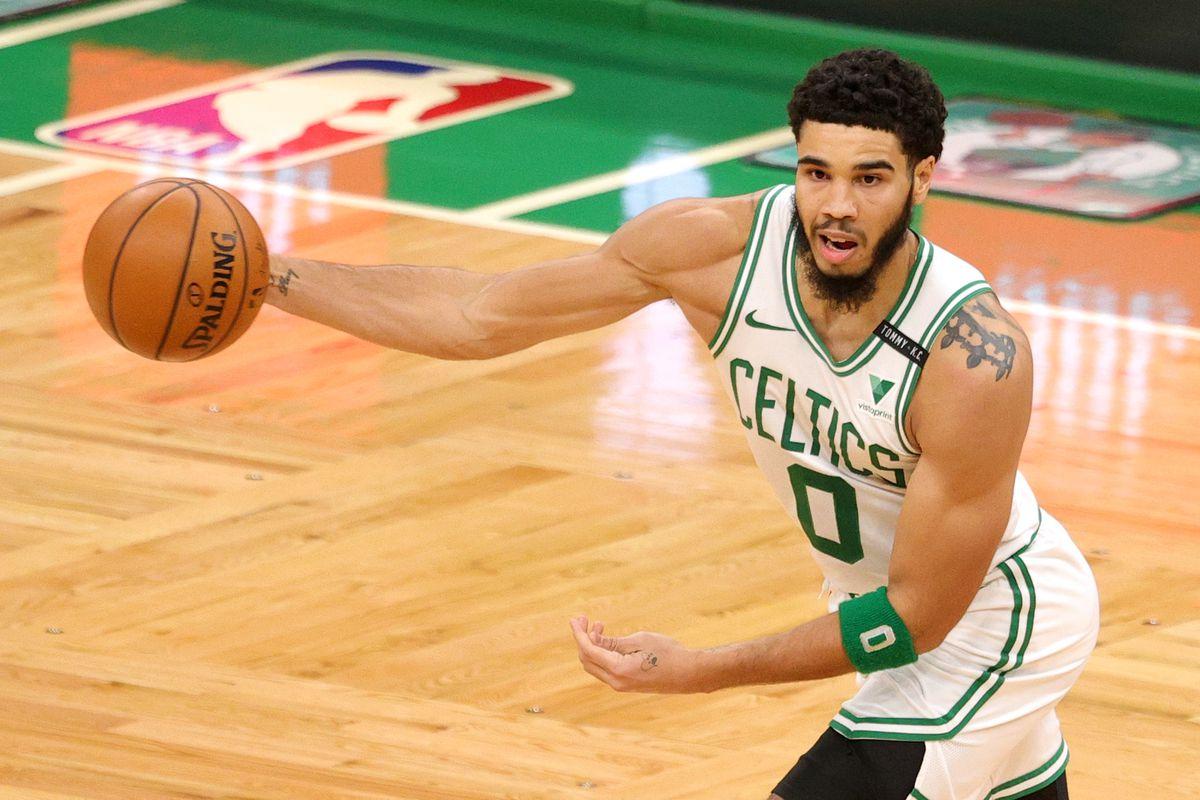 Jayson Tatum of the Boston Celtics makes a pass against the Washington Wizards at TD Garden on January 08, 2021 in Boston, Massachusetts