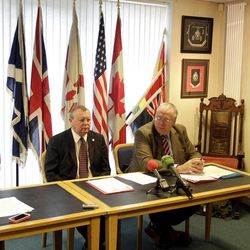 Orange Order members Dr David Hume, left, Grand Secretary Drew Nelson, centre, and Grand Chaplin  Mervyn Gibson, right,  speak to the media during a press conference in East Belfast, Northern Ireland, Wednesday, Sept. 26, 2012.  The Orange Order announced that Saturday's Ulster Covenant celebration were tens of thousands of Protestants will parade in Belfast to mark the centenary of the signing of the . The parade organised by the Grand Orange Lodge of Ireland is expected to be the largest demonstration witnessed in Northern Ireland. The covenant was signed in 1912 to oppose Irish Home Rule.