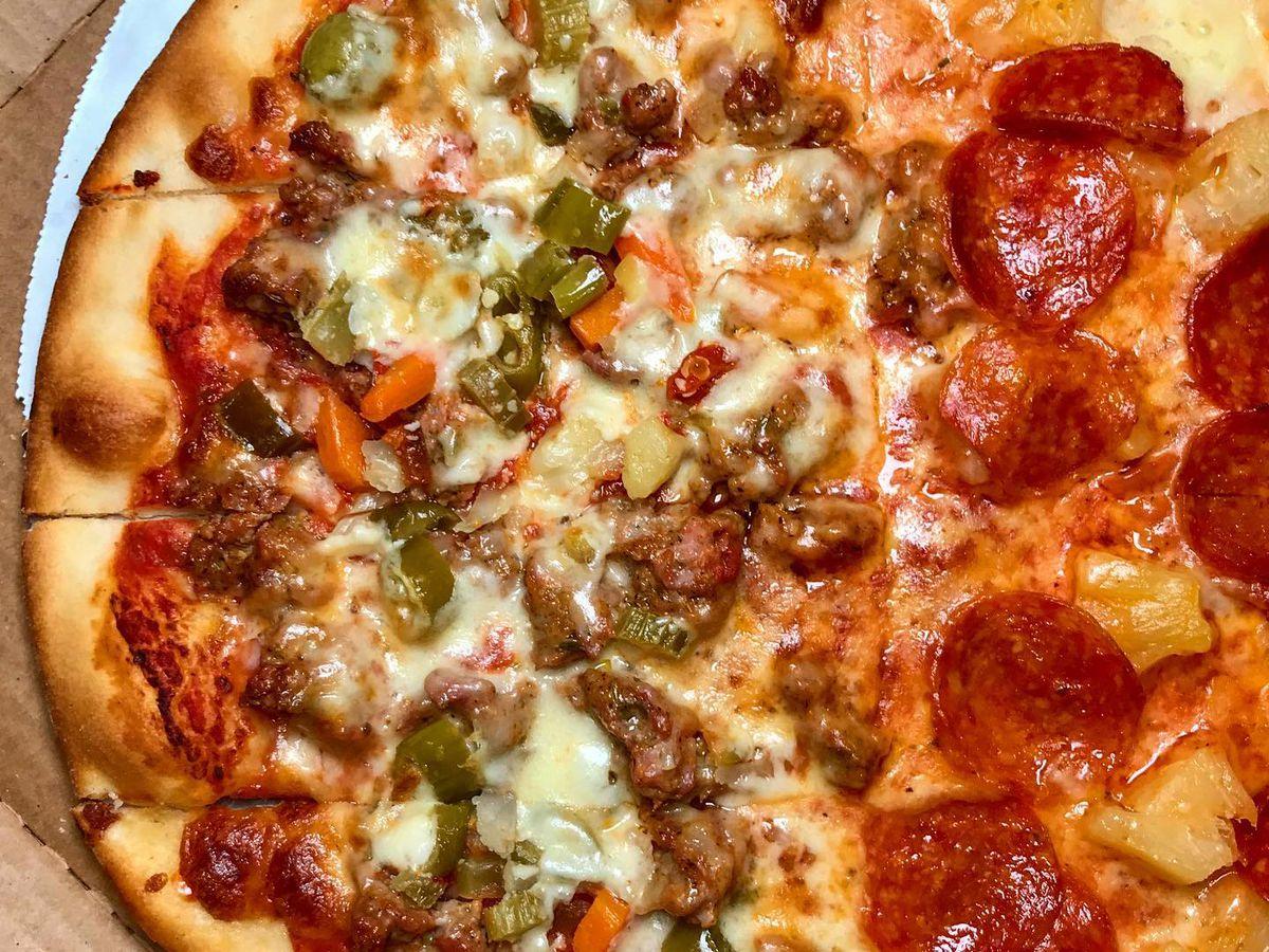 A sausage, giardiniera, pepperoni, and pineapple tavern-style pizza.
