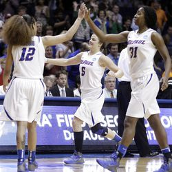 DePaul guard Anna Martin (5), guard Brittany Hrynko (12) and forward Jasmine Penny (31) celebrate after they defeated BYU 59-55 during an NCAA tournament first-round women's college basketball game in Rosemont, Ill., Saturday, March 17, 2012. (AP Photo/Nam Y. Huh)