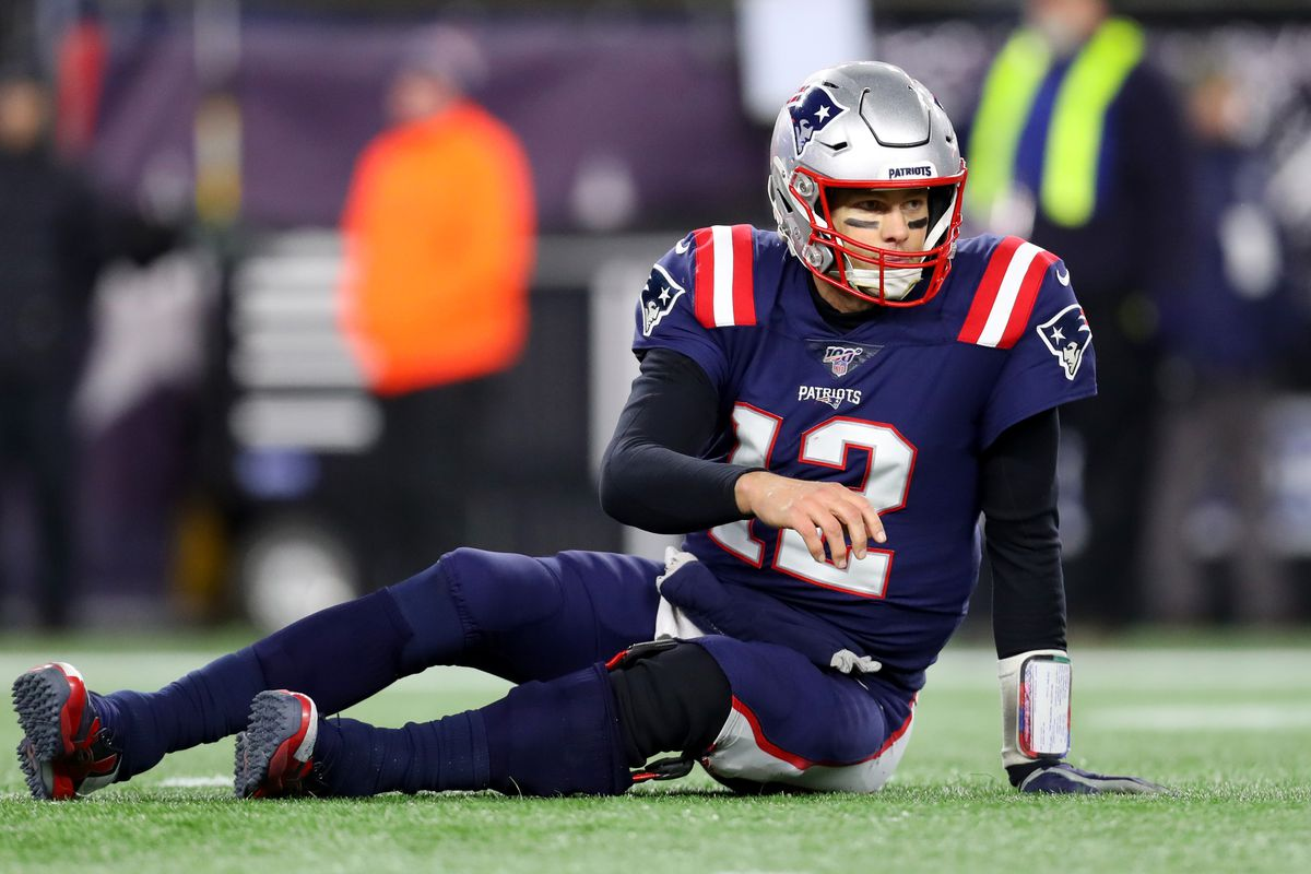 Tom Brady of the New England Patriots looks on from the ground during the fourth quarter of the game against the Kansas City Chiefs at Gillette Stadium on December 08, 2019 in Foxborough, Massachusetts.