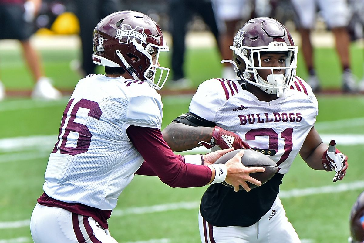 Quarterback Jack Abraham of the Mississippi State Bulldogs hands the ball of to running back Jo'Quavious Marks during the Maroon and White spring game at Davis Wade Stadium on April 17, 2021 in Starkville, Mississippi.