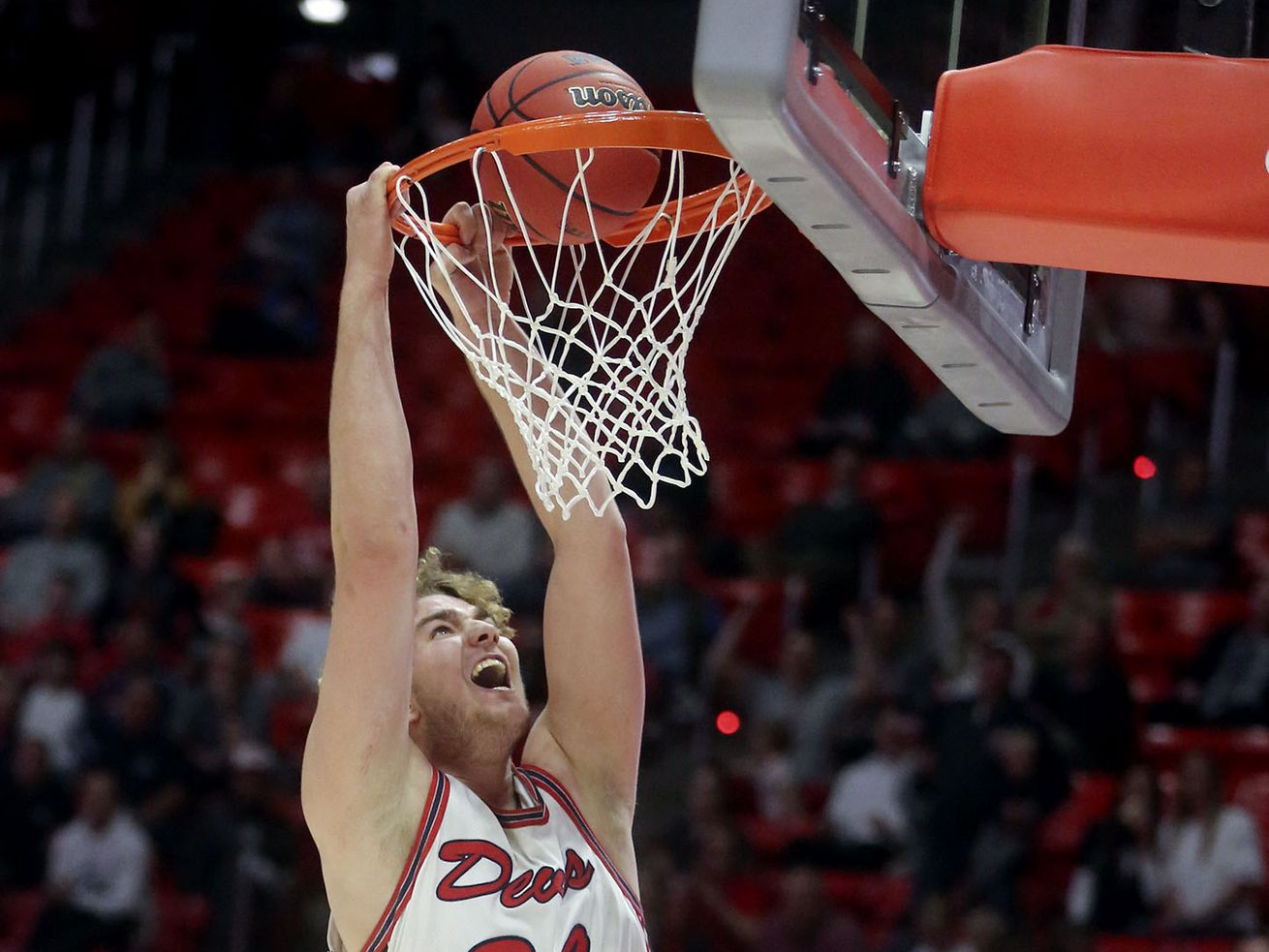 Springville's Zachary Visentin smiles while attempting a dunk right before the ball bounces out during the 5A boys basketball state quarterfinals against Bountiful at the Huntsman Center in Salt Lake City on Tuesday, Feb. 25, 2020. Springville won 65-60.
