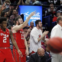 Utah Utes players and coach celebrate a three pointer in the second half against the Utah State Aggies during NCAA basketball at Vivint Smart Home Arena in Salt Lake City on Saturday, Dec. 9, 2017.