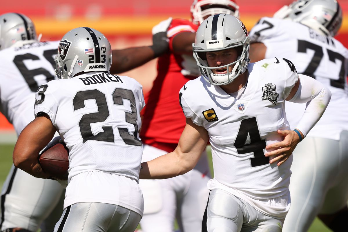 Derek Carr #4 of the Las Vegas Raiders hands the ball off to Devontae Booker #23 against the Kansas City Chiefs during the second quarter at Arrowhead Stadium on October 11, 2020 in Kansas City, Missouri.