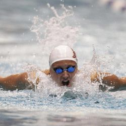 Katinka Hosszu takes a breath on her way to winning the women's 100-meter butterfly event at the Indianapolis Grand Prix swimming meet in Indianapolis, Saturday, March 31, 2012.