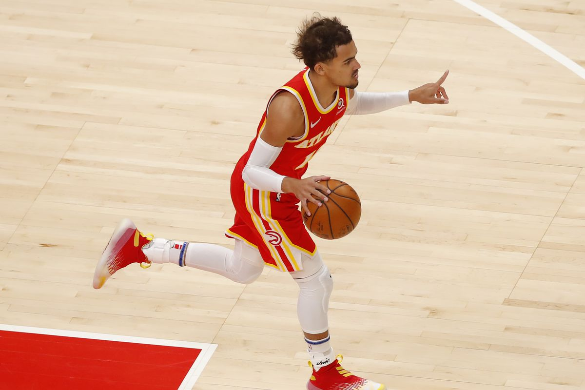 Trae Young of the Atlanta Hawks drives down the court during the first half against the Memphis Grizzlies at State Farm Arena on April 7, 2021 in Atlanta, Georgia.