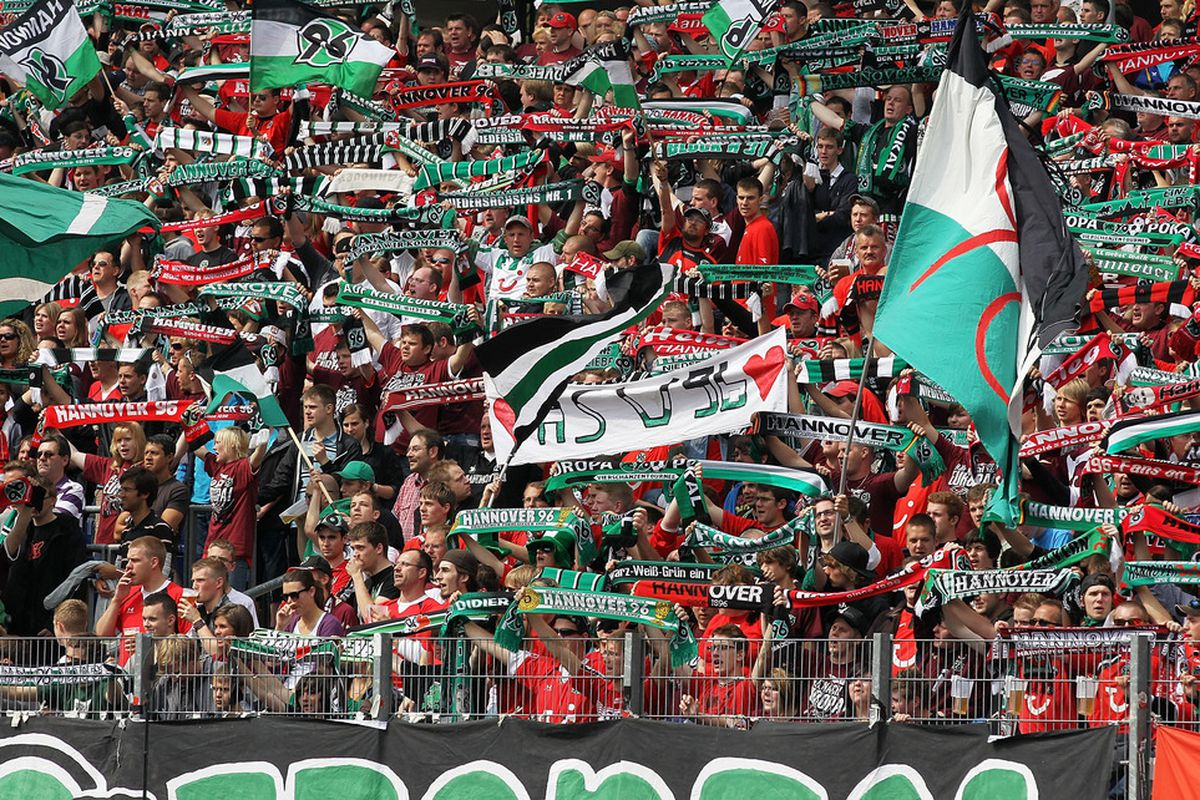 HANOVER, GERMANY - MAY 14:  Fans of Hannover celebrate during the Bundesliga match between Hannover 96 and 1. FC Nuernberg at AWD Arena on May 14, 2011 in Hanover, Germany.  (Photo by Boris Streubel/Bongarts/Getty Images)