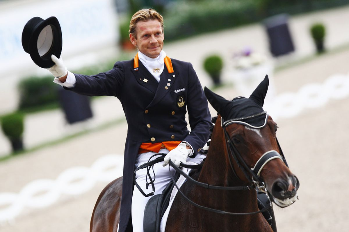 AACHEN, GERMANY - JULY 14: Edward Gal of Netherlands on his horse Sisther de Jeu waves during the 'Preis der Teschinkasso' dressage competition at the CHIO on July 14, 2011 in Aachen, Germany.  (Photo by Alex Grimm/Bongarts/Getty Images)