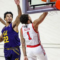 Utah Utes forward Timmy Allen (1) dunks in front of California Golden Bears forward Andre Kelly (22) during the game at the Huntsman Center in Salt Lake City on Saturday, Jan. 16, 2021.