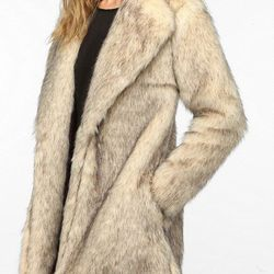 """<strong>MINKPINK</strong> Cruella Faux Fur Coat at Urban Outfitters, <a href=""""http://www.urbanoutfitters.com/urban/catalog/productdetail.jsp?id=25853508&parentid=SEARCH+RESULTS#"""">$190</a>"""